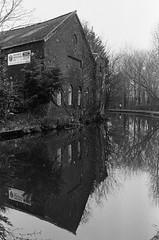 Bridgewater Canal (PaulEBennett) Tags: film mono blackandwhite ilford400 runcorn canal bridgewatercanal reflection pentaxk1000