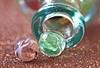 Out of the bottle (Through Serena's Lens) Tags: smileonsaturday roundandround marbles glass bottle bokeh dof stilllife