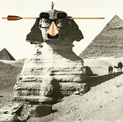 Vandals Attack Tourist Destinations (Jeff Burger) Tags: sphinx giza egypt oedipus manticore lamassu parody vandals pranks jokeglasses touristdestinations fuzzypuss fauxnose arrowthroughthehead jeffburger culturalicon narasimha pyramids pharaohs ancientegypt deserts