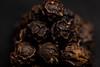peppercorn pyramid (jlodder) Tags: black pepper peppercorn pyramid stack cannonballs lowkey macromondays condiment flickrfriday roundshapes