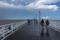 sunshine after the rain (Greg Rohan) Tags: saltwater sea ocean photographers people blue sky clouds wet boards water brisbane pier shorncliffepier shorncliffe sandgate d750 2018 nikon nikkor beach seaside walkway waterfront lines