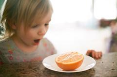 orange you glad to see me? (phatwhistle) Tags: michigan leelanau orange portrait film analog superia canonft fl5014ii fruit