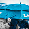 Sheltering from the Rain (FotoFling Scotland) Tags: bute butehighlandgames event rothesay highlandgames isleofbute rain umbrella fotoflingscotland