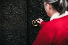 seeking answers (ewitsoe) Tags: 23c april bright canoneos6dii city cityscape day ewitsoe inspiration spring urbansetting warm warszawa erikwitsoe poland streetphotography urban warsaw wawa redcoat doorhandle church cathedral lady woman pray