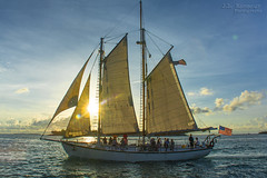 Sunset Sailing - Key West, Florida (J.L. Ramsaur Photography) Tags: jlrphotography nikond5200 nikon d5200 photography photo keywestfl thekeys monroecounty florida 2014 engineerswithcameras floridakeys photographyforgod thesouth southernphotography screamofthephotographer ibeauty jlramsaurphotography photograph pic islandtime keywest conchrepublic southernmostcityinthecontinentalus southernmostcity keywestflorida homeofthesunset tennesseephotographer cayohueso isleofbones boneisland thelastresort americanflag usflag redwhiteblue starsandstripes oldglory patriotic patrioticproud starsandbars redwhiteandblue americana america usa unitedstatesofamerica sailboat sailing sunsetsailing sunset sun sunrays sunlight sunglow orange yellow blue bluesky deepbluesky beautifulsky whiteclouds clouds sky skyabove allskyandclouds wherethemapturnsblue ocean bluewater blueoceanwater sea engineeringasart ofandbyengineers engineeringisart engineering