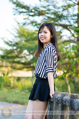 yellow sunlight evening (Hosting and Web Development) Tags: eyes smile baluster stand park vietnam vertical tree green yellow summer sunlight casual clothing shoulder woman femininity female bokeh happy hair d7100 emotion nikon young one person asia afternoon face arm body