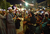 A woman dances in a cafe near Al Sayeda Zaynab mosque while a Folkloric music group plays (Haleem Elsha3rani حليم الشعراني) Tags: cairo egypt sufi religion religious northafrica africa middleeast middleeastern muslim islam music mosque dancing amusment