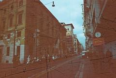 Roma (Streak) (goodfella2459) Tags: nikon f4 af nikkor 24mm f28d lens revolog streak 200 35mm c41 film analog colour italy roma street buildings sign road rome manilovefilm