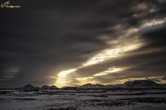 Light Breaks Through (Gavmonster) Tags: gswphotogrpahy nikon d7500 mountain iceland winter snow naturalwonder sky white clouds sun sunlight rays beams orange light