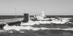 Winds from the East (wilbias) Tags: wave pier water surf seascape waves angry windy lake ontario canada burlington lift bridge black white monochromatic