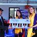 Handing over replica of school to Principal, Petra & U by U representative