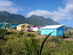 St Kitts = colourful houses near scenic railway line (rossendale2016) Tags: free mortgage purchased rented council double single homes starter value cheap accomodation brightly bright build built joined fabricated fabric colour structures prefabricated prefab oofs roof metal tin wooden track trackside iconic unusual viewed seen photographs photo picturesque photogenic new sky blue clouds mountain roadside coloured pastel tourist holiday railway scenic houses caribbean kitts st