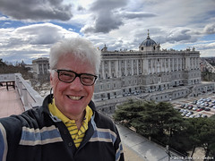 Me and the Royal Palace (David J. Greer) Tags: madrid spain travel man male smile smiling grey hair royal palace terrace day daytime light bright cloudy sky yellow shirt glasses