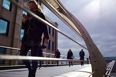 IMG_3653 (JetBlakInk) Tags: candid composition perspective women streetphotography millenniumbridge iphonex subjecttoground