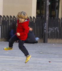 Square in Barcelona on  Sunday (emmett.hume) Tags: fun play boy square barcelona top red immersion focus jump 1025fav