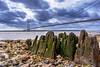 Shoreline Groin.jpg (Almac1879) Tags: wood shoreline neglect landscape bridge wooden humberbridge humber landscapes shore groin hessle sky river pebblebeach bridges weathered pebbles groins decay worn beach water