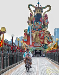 Bike Ride (Kostas Trovas) Tags: ancient kaohsiung action statue 玄天上帝神像kaohsiung street taiwan warrior thegreatwarrior chinesemythology bikeride background people tradition