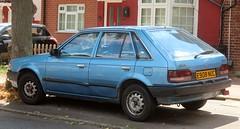 E908 NUC (Nivek.Old.Gold) Tags: 1987 mazda 323 lx 5door 1296cc