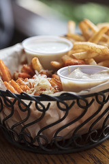 Wire basket filled with sweet potato and french fries served with aioli sauce and ranch dressing (Transient Eternal) Tags: food restaurant gourmet cuisine frenchfries fries sweetpotato yam sweetpotatofries ranchdressing dressing gratedcheese parmesan garlic aiolisauce sauce dip meal lunch dinner eat cook fry fried basket serving tasty savory delicious fattening greasy grease textures tablesetting creamy hot warm plate paperplate crunchy grated fastfood