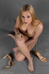 Helpless (piotr_szymanek) Tags: olivia oliviad portrait studio woman young skinny feet legs hand face eyesoncamera blonde longhair boots highheels 1k 20f 50f 5k cleavage 10k 100f 20k 30k closeup 150f