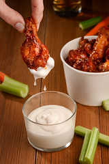 Fried chicken drumstick and mayonnaise (foodio) Tags: hand finger chicken drumstick buffalo barbecue bbq mayonnaise dip ranch sauce yummy tasty delicious hot brown ruddy crust poultry meat fried roasted prepared cook celery carrot stick beer dinner meal dish lunch appetizer calorie snack paper cup bucket eat unhealthy nutrition wooden table background fast food american cuisine recipe pub