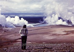 Boiling Mudfield at Lake Mývatn (john shortland) Tags: iceland icelandic sweater jumper girl woman steam mud field lakemyvatn mountain lava volcanic boiling 1972 vintage slidetodigital wool