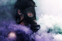 Pollution (Ridgway Imagery) Tags: fineartphotography fineartphotographer fineartportrait fineart conceptualphotography conceptualphotographer conceptualportrait conceptualart conceptual surrealphotography surrealphotographer surrealportrait surreal performancephotography performanceart performance malemodel malesubject male subject model photography photographer flickr instagram outdoor nature field closeup gasmask mask gas toxic atmosphere atmospheric portrait colouredsmoke smoke smokegrenades bursts green white purple dramatic intense lost fog swarm anxiety stress negativity personalcontext self explorationofself findingmyway developing pollution wasteland survive apocalyptic fantasy constructednarrative constructed narrative story idea character passion emotions emotion battle ridgwayimagery student degree oldwork