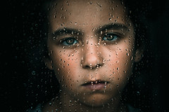 Can't you see that it's just raining there ain't no need to go outside—Jack Johnson- (Lorrainemorris) Tags: lorrainemorris feeling sony zeissbatis85 portrait naturallight cinematic child emotion moody raindrops batis sony7rm2 zeiss window raining