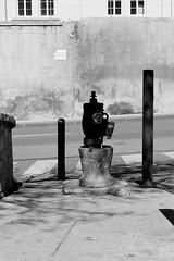 Silhouette pompier (ZUHMHA) Tags: marseille france road street rue monochrome urban urbain pompier line lignes courbes curve geometry géométrie ombre lumière shadow light ombreetlumière grille grillage fence poteau letter lettre mot word sign texte text écriture