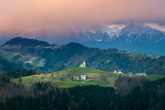 St. Thomas church / Sveti Tomaž (Aljaž Vidmar | ADesign Studio) Tags: grass spring stthomas landscape gorenjska church alps mountains clouds trees slovenia countryside nature showers magenta layers purple green slovenija rain sunset dramatic