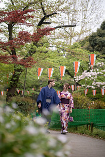 Multi-Ethnic couple walking together in public park