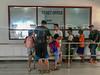 Adi's helping us get our tickets (Stinkee Beek) Tags: lombok bangsal adi leonard erin ethan
