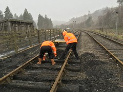 Phill and Lee dig out ash around the sleepers north of the crossing in snow 17Mar18