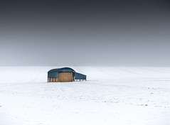 Black barn in a field of snow (Anthony White) Tags: sixpennyhandley england unitedkingdom gb snow barn hay nopeople anthonywhitesphotography a7r tracks nature naturaleza building colour weather neige white black sneeuw schnee