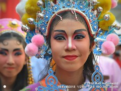 2018-02a Bangkok Chinatown (57) (Matt Hahnewald) Tags: matthahnewaldphotography facingtheworld live aesthetic springfestival chinesenewyear parade performer dancer makeup lunaryear festival head face painted eyes costume consent fun entertainment travel tourism culture tradition enjoyment socialevent diversity impact traditional cultural folklore touristattraction celebration historical yaowarat bangkok chinatown thailand thaichinese asia twopeople image photo faceperception physiognomy nikond3100 primelens 50mm 4x3 horizontal street portrait doubleportrait closeup outdoor color colorful posingforcamera iconic awesome incredible authentic sightseeing partying photography ambiguity attire headgear softfocus character relationship fullfaceview lookingcamera headshot