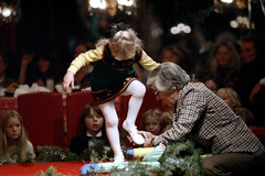 1a-764 (ndpa / s. lundeen, archivist) Tags: nick dewolf nickdewolf photographbynickdewolf 1978 1970s color 35mm film 1a reel1a aspen colorado fashionshow communityfashionshow socialevent people decorations curtains redcurtains model children kids child boy girl girls seated sitting audience chairs man grayhair glasses blond blonde dress stockings men women