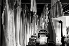 Shades Of Laundry (Alfred Grupstra) Tags: indoors nopeople clothing blackandwhite fashion coathanger store elegance hanging domesticroom textile retail architecture huisvangijn dordrecht