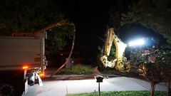 Backhoe excavates trench in drive. (spelio) Tags: act canberra construction building