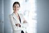 Smiling Female Business Leader With Arms Crossed (nextaff) Tags: person single female woman young adult middleaged caucasian brunette lady formal jacket office hall crossed arm folded standing posing looking camera smiling happy confident proud selfassured calm content successful smart professional businesswoman executive manager leader chief boss agent representative business pretty attractive beautiful elegant portrait background indoors horizontal closeup halfturned