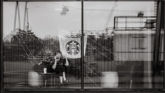 surrounded by reflections (Gerard Koopen) Tags: nederland netherlands amsterdam city capital bw blackandwhiteonly blackandwhite girl coffee reflections waiting break nikon d810 straat street straatfotografie streetphotography candid 2018 gerardkoopen streetlife