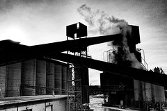 Halsted Street - 1 of 3 (draketoulouse) Tags: chicago city factory street streetphotography blackandwhite monochrome urban sunset construction smoke steam