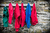 15th March 2018 (Rob Sutherland) Tags: waterproof clothing childrens waterproofs kagouls jacket trousers pants wall stone barn hooks hanging up hung peg pegs red blue green outdoor outdoors education health healthy outwardbound fit fitness activity walk walking cumbria cumbrian england english uk britain british
