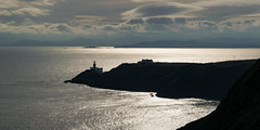 Howth lighthouse (Rickalpha42) Tags: lighthouse howth ireland landscape sea water sky clouds light silhouette dark peninsula sun hike hiking travel nikon photo photography seascape gold