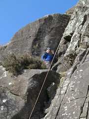 waving from ledge (squeezemonkey) Tags: northwales snowdonia winter castlestafftrip tremadog tradclimbing climbing outdoors doleriterock craigpantifan uppertier crag climber