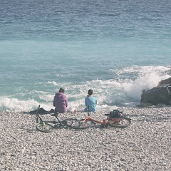Cycle by the sea (Azmarina Tanzir) Tags: bicycle sea wave boy blue ocean nice frenchcoast frenchriviera beach