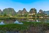 In the middle of nowhere (Enrique EKOGA) Tags: ninhbinh vietnam landscape hills travel bluesky sky water nature colors tamcoc nikon d800e tokina asia