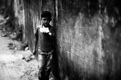Little Boy Blues (N A Y E E M) Tags: boy neighbour candid portrait today afternoon street rabiarahmanlane chittagong bangladesh windshield