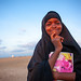 Portrait of a somal girl in black veil with a school book, Awdal region, Zeila, Somaliland
