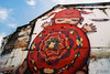 Red Turtle (D. R. Hill Photography) Tags: thailand asia southeastasia phuket phuketoldtown graffiti art streetart nikon nikonfe2 fe2 135 35mmfilm analog film fuji fujifilm fujisuperiaxtra400 superia alexface redturtle voigtlander voigtlandercolorskopar20mmf35 voigtlander20mm 20mm primelens fixedfocallength manualfocus cosina mardi