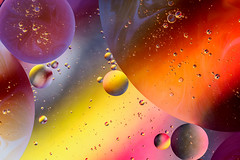 Oil and Water (Alison T23) Tags: planets oilandwater singularity physics space bubbles colour light spectrum cosmic ethereal creative beauty simplicity complexity science earth experiment saveourplanet olympusuk olympusomd